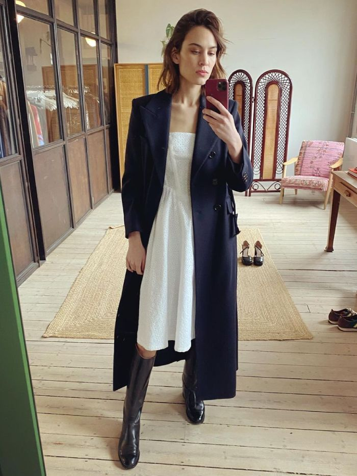 alexa dress and coat spring outfit 2021: alexa wearing a white dress with blue coat and boots