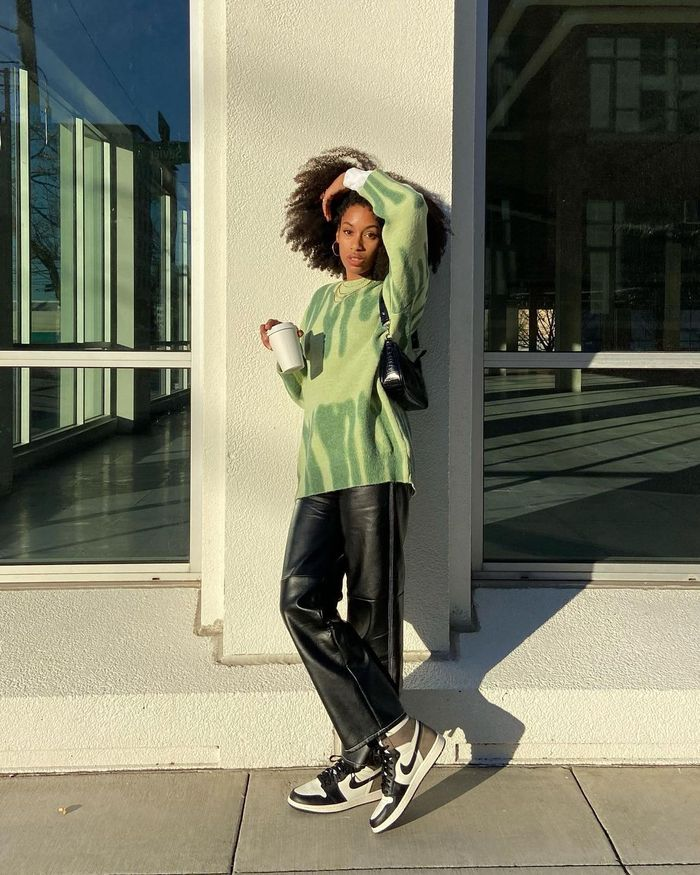 Outdoor Outfit Ideas: @claire_most wears a slouchy sweater and leather trousers