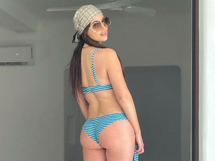 Kacey Musgraves wore a blue striped bikini swimsuit by Frankies Bikinis