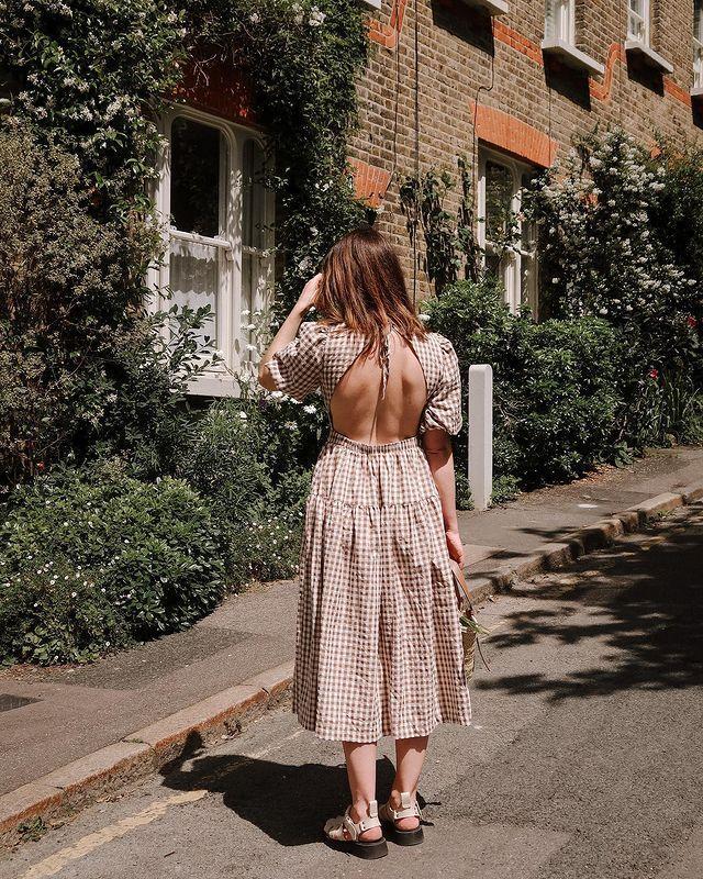 Trending Dresses 2021: @francescasaffari wears a backless gingham dress from Warehouse