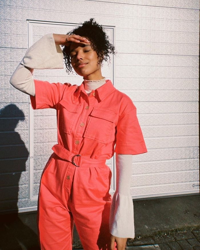 Best Sunscreen for Face: Fia wearing coral jumpsuit