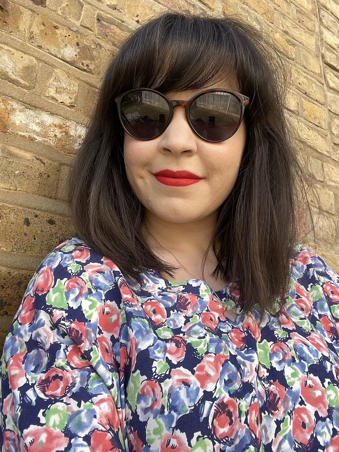 Best Long-Lasting Lipsticks: Mica Ricketts wearing red lipstick and sunglasses