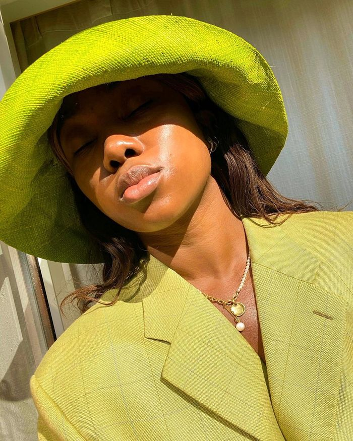 How to get rid of acne: Nnenna Echem wearing green sunhat and blazer