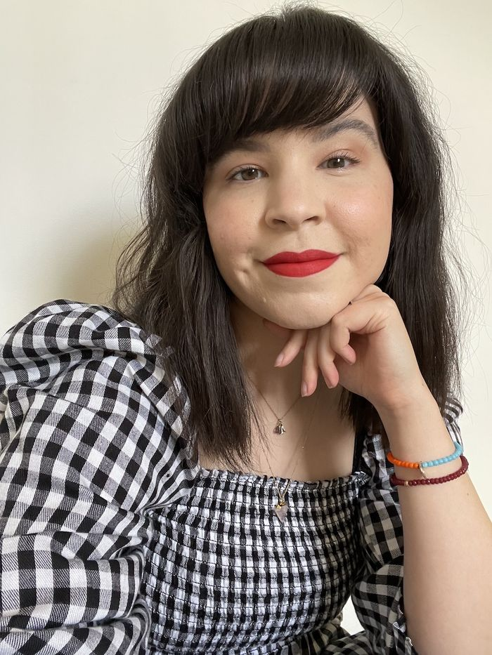 Best Maybelline Products: Mica Ricketts wearing gingham dress and red lipstick