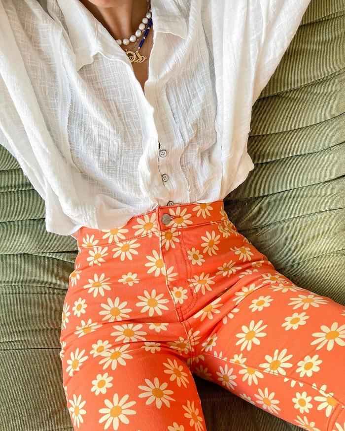 best printed jeans: orange daisy print denim at Free People