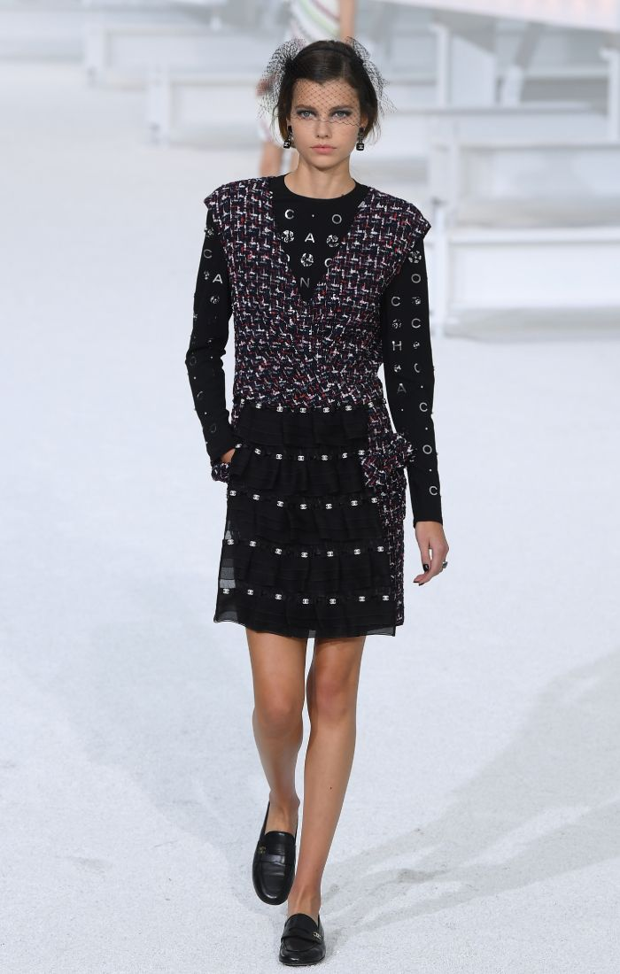 chanel loafers: a model wearing chanel loafers on the spring/summer 2021 runway