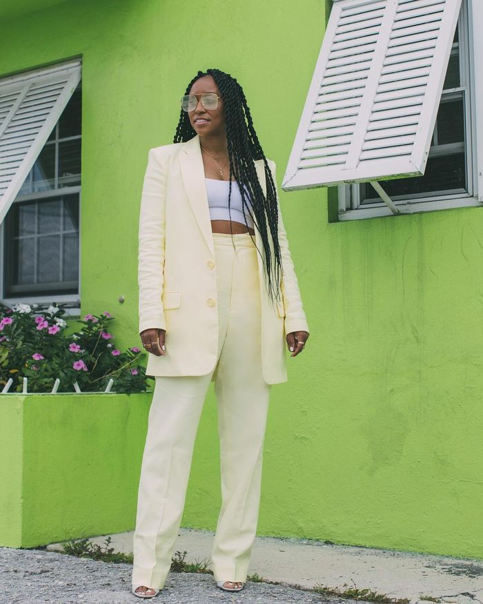 bra and blazer outfits: yellow trouser suit with a white crop top