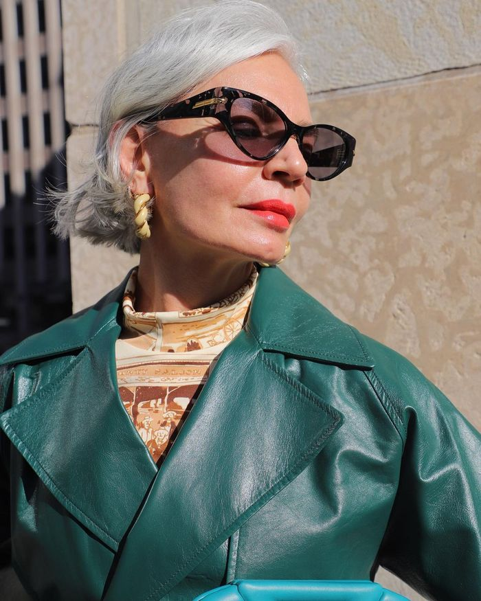 Best Retinol Creams: Grece Ghanem wearing sunglasses and green trench