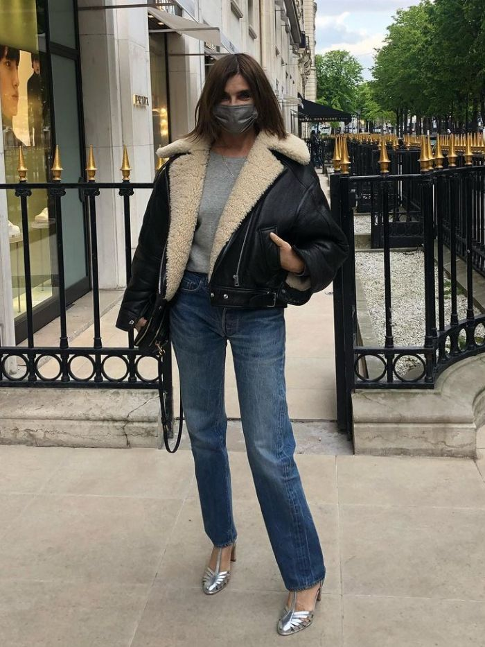 carine roitfeld jeans: the fashion editor wearing jeans, silver shoes and a grey t-shirt and aviator jacket