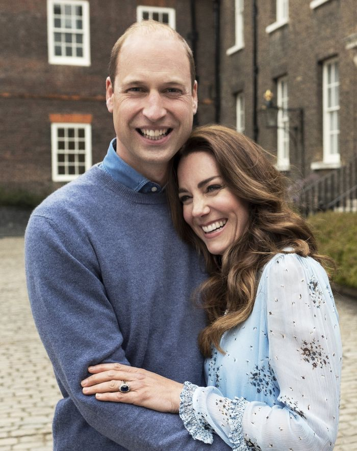 kate middleton wears a blue dress for her wedding anniversary portraits