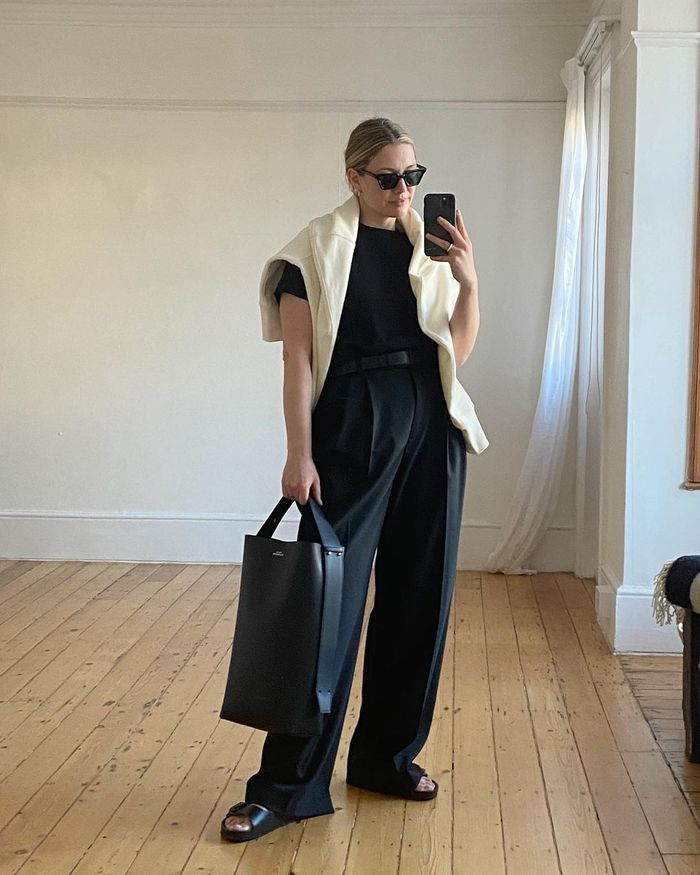 chic outfit ideas: black tailoring with a cream jumper