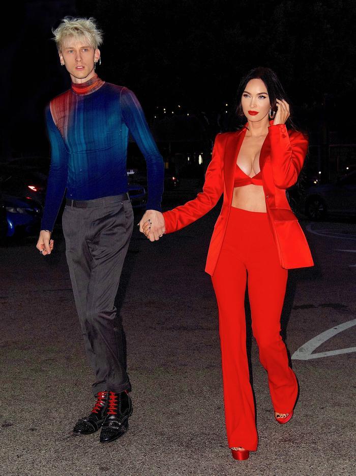 Megan Fox wearing a red pantsuit with Machine Gun Kelly