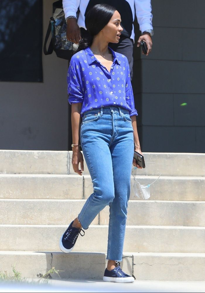 Zoe Saldana wore affordable Superga sneakers with skinny jeans