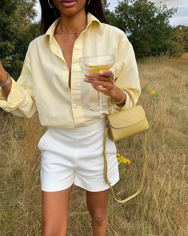H&M Summer Outfits: @SYMPHONYOFSILK wears a yellow linen shirt with white shorts