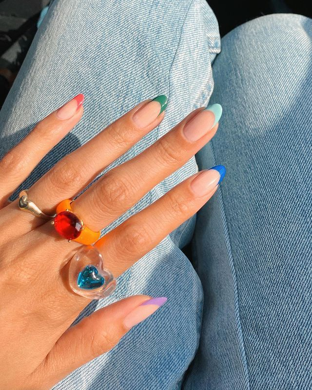 Summer Nail Trends: @overglowedit with a rainbow French manicure