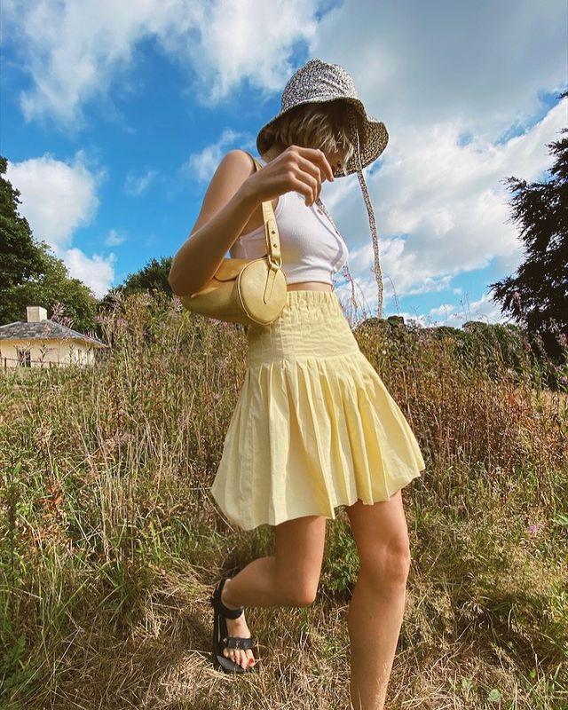 Cute Outfit Ideas: @chloekathbutler wears a yellow pleated mini skirt