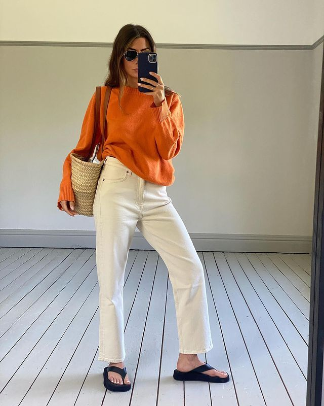 Cute Outfit Ideas: @smythsisters wears an orange knit with ecru jeans
