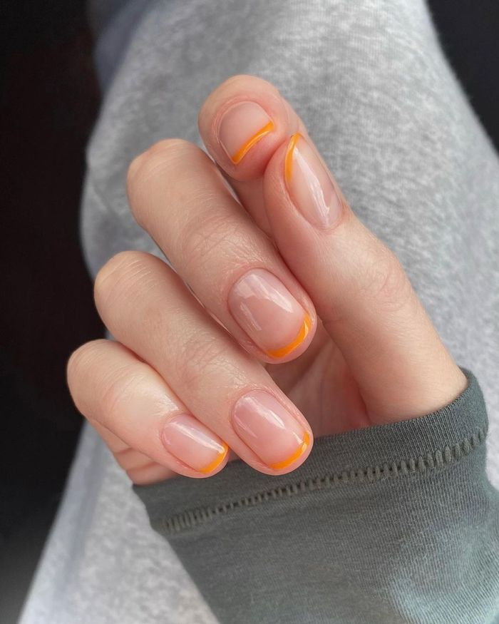 Colourful French manicures: Apricot tops