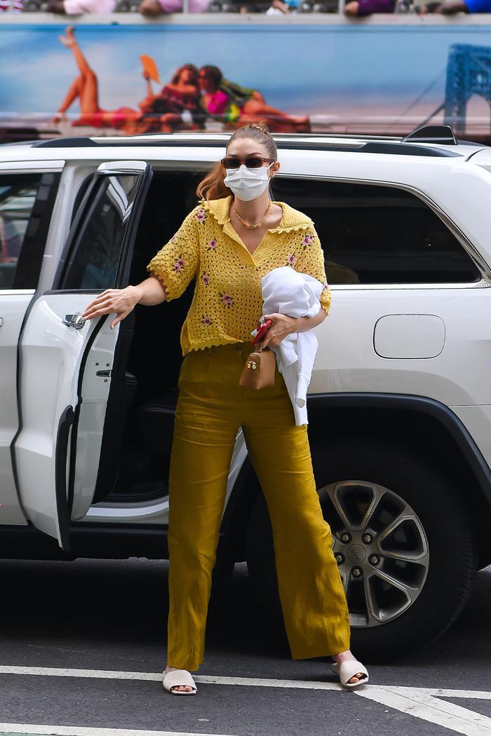 Gigi Hadid in a yellow crochet polo top from Mango