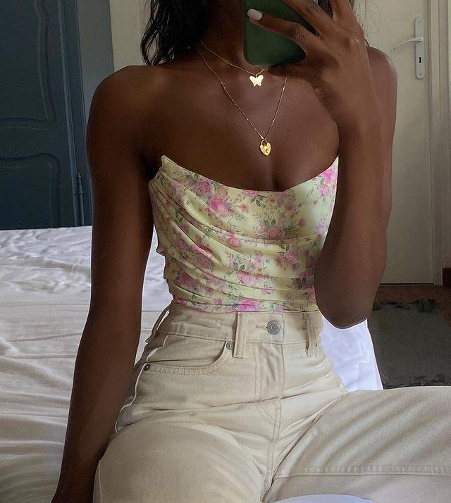 Strapless Summer Tops: @emmanuellek_ wears a floral strapless top with ecru jeans