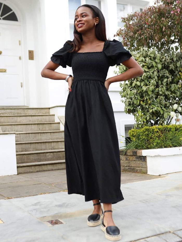 best new look summer dresses: eni wearing a black new look dress