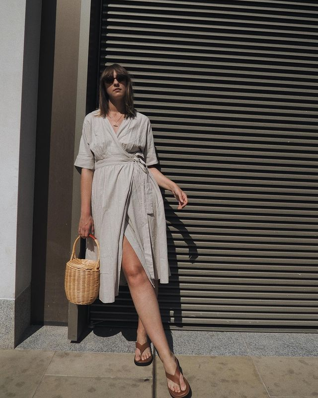 Marks and Spencer Sandals: @bubblyaquarius wears M&S sandals with a beige wrap dress and basket bag