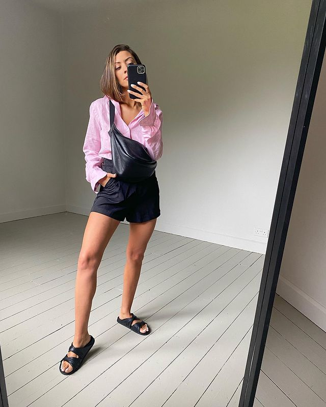 How to Style an Oversized Shirt: Marianne wears a pink shirt tucked into black shorts