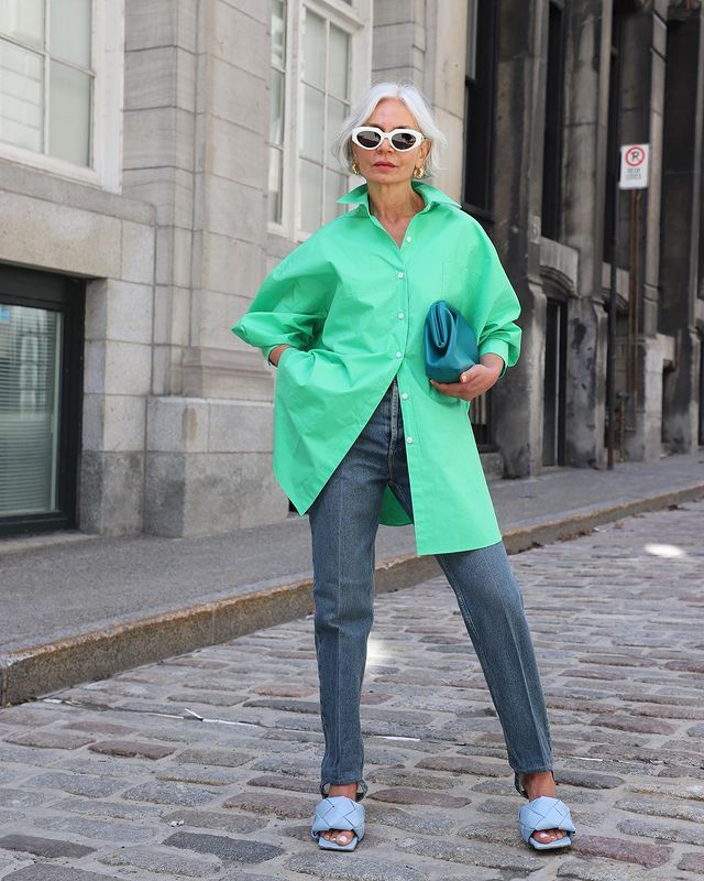 How to Style an Oversized Shirt: Grece wears a green oversized shirt with tailored jeans and mules