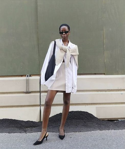 How to Style an Oversized Shirt: Sylvie wears an oversized shirt with a beige mini skirt and heels