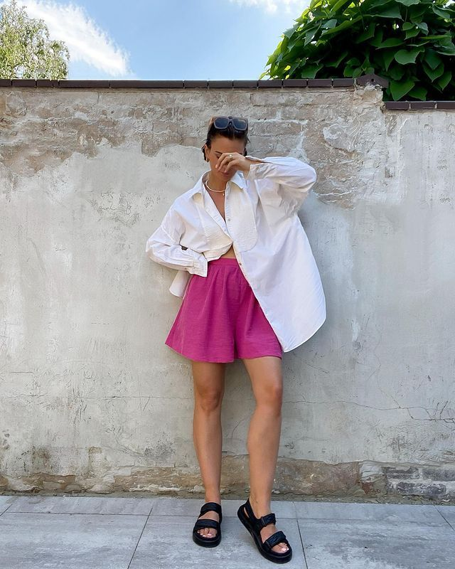 H&M, COS, and & Other Stories Summer Collections: Naaomi Ross wears a pair of hot pink shorts from H&M with a white shirt from Arket