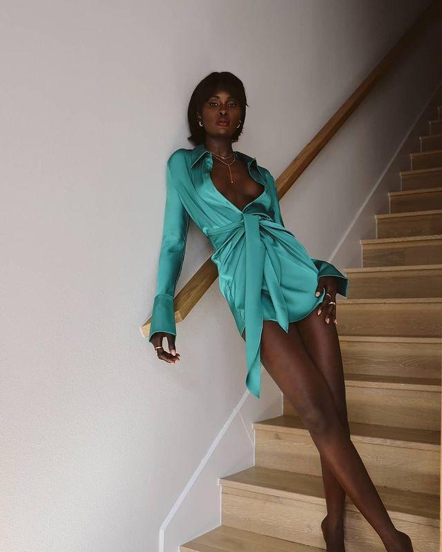 Rat and Boa Dresses: @lefevrediary wears a teal satin mini dress from Rat & Boa