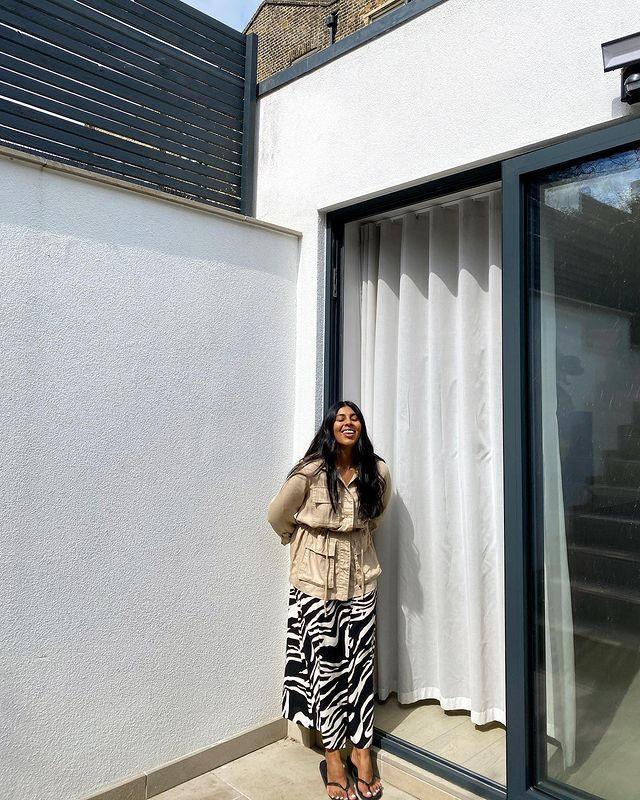 Animal Print Skirts: @monikh wears a zebra print skirt with a safari jacket