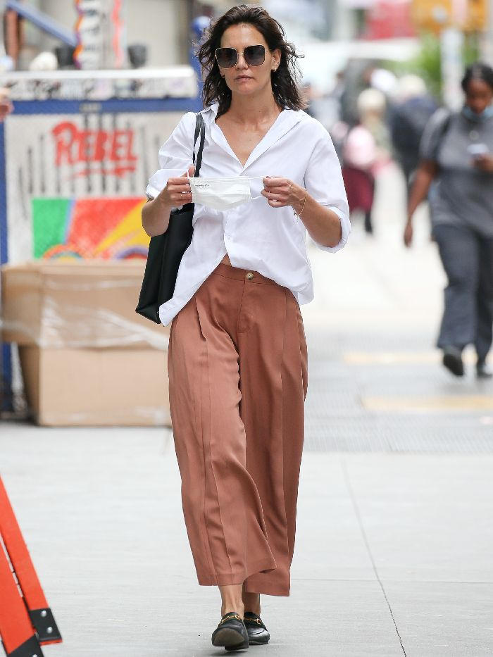 katie holmes pleated trousers: katie holmes wearing a white shirt with gucci loafers and pleated trousers