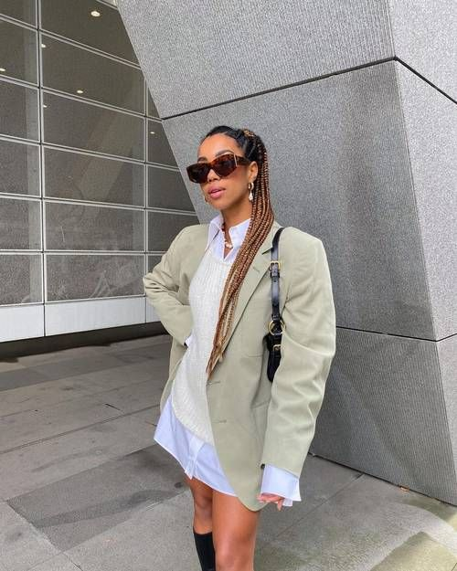 Best Oversized Blazers: Amaka wears a light green oversized blazer with cream knitwear