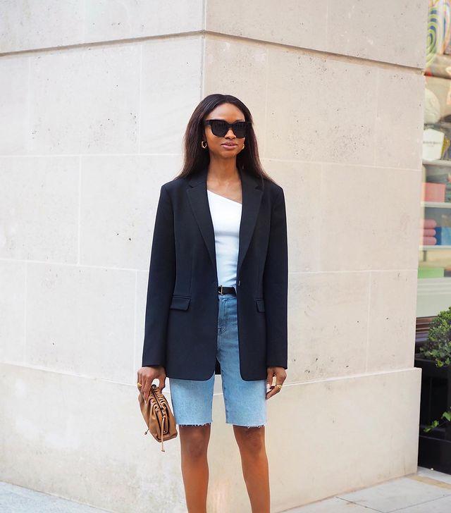 Black Blazer Outfits: @symphonyofsilk wears a black blazer with denim shorts