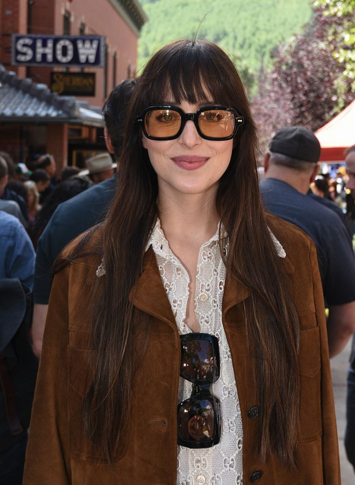 Dakota Johnson in a suede Nili Lotan jacket and Gucci sunglasses