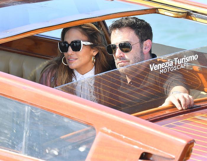 Jennifer Lopez and Ben Affleck in Venice, wearing a white lace dress