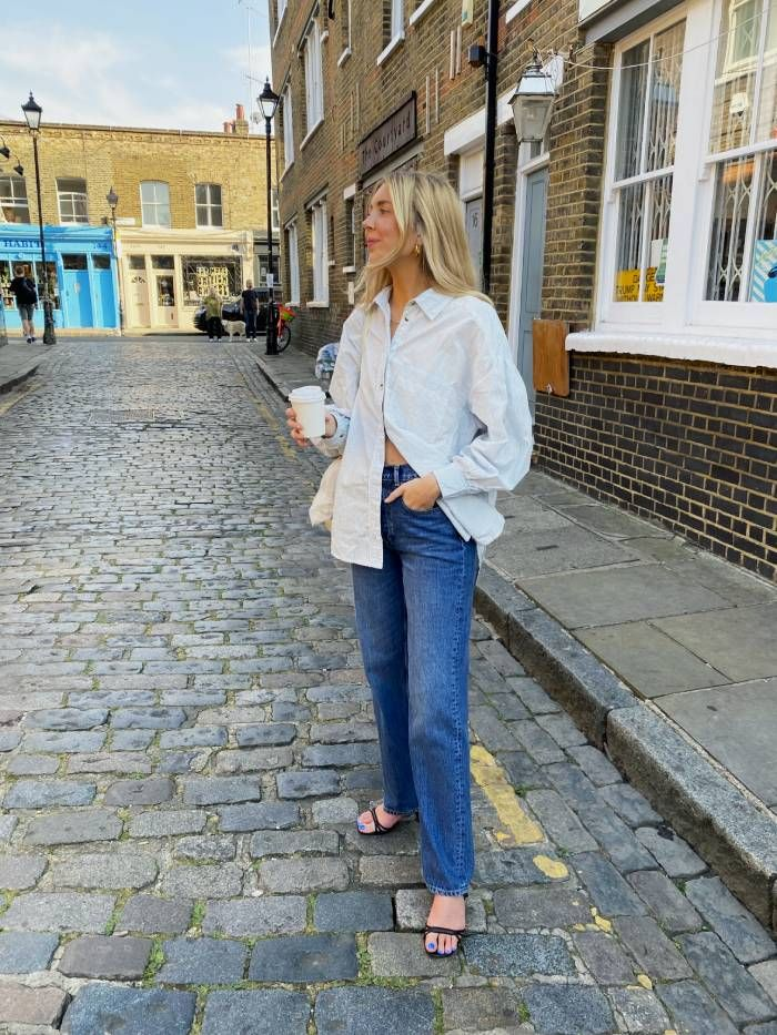 Michelle Driscoll wears Free People shirt and jeans