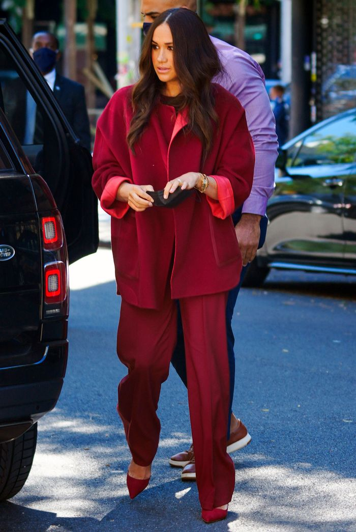 Meghan Markle wearing a red slouchy pantsuit