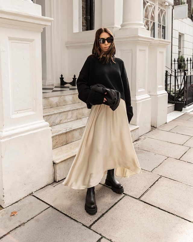 Autumn Skirt Outfits: @_jessicaskye wears a black knitted jumper with a cream midi skirt