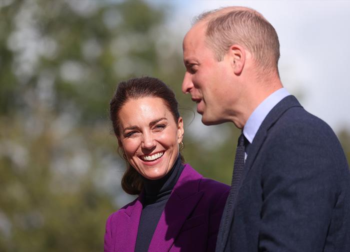 Kate Middleton, Duchess of Cambridge wearing a purple Emilia Wickstead suit