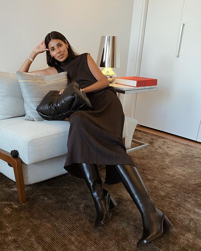 Leather Knee-High Boots: @babba wears a pair of classic black leather knee boots