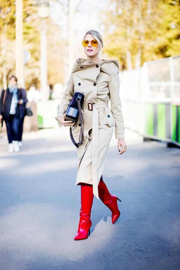 For a colder winter day, buckle up your simple trench, and let a statement piece shine (like these leather red boots).
