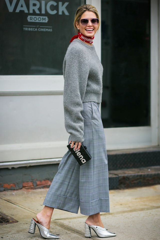 When in doubt, this combination is pretty muchfoolproof: crewneck sweater + wide-leg cropped trousers + heeled mules.