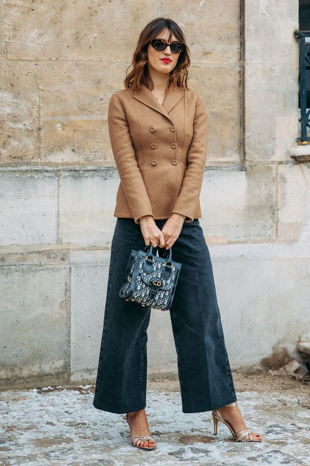 This is how we imagine the French would approach an interview outfit. Worn with wide-leg pants, a brown blazer can look just as professional as a black one. Finish off the look with neutral heels.