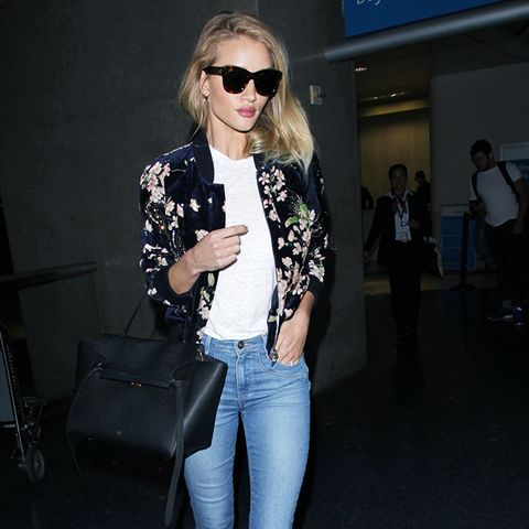 Rosie Huntington-Whiteley wears skinny jeans and strappy heels.