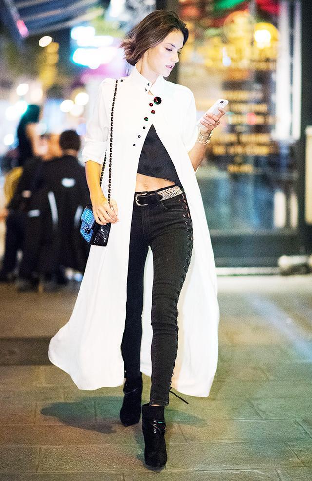 Alessandra Ambrosio wearing a white coat.
