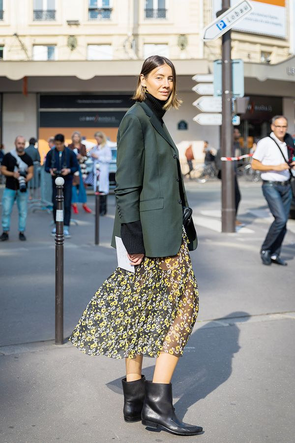 Ground flirty florals with leather boots and a boxy blazer.