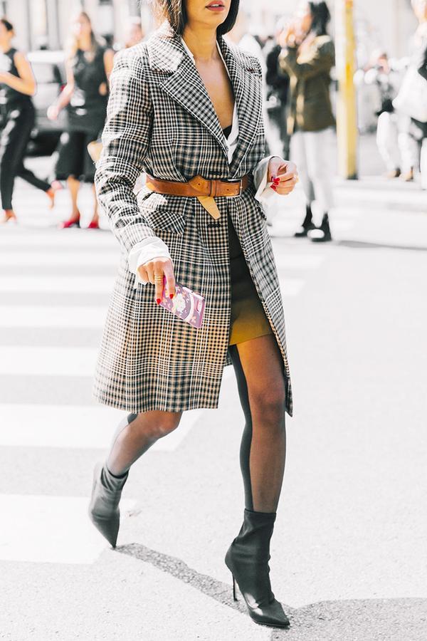 Throw on a stylish checkered coat.