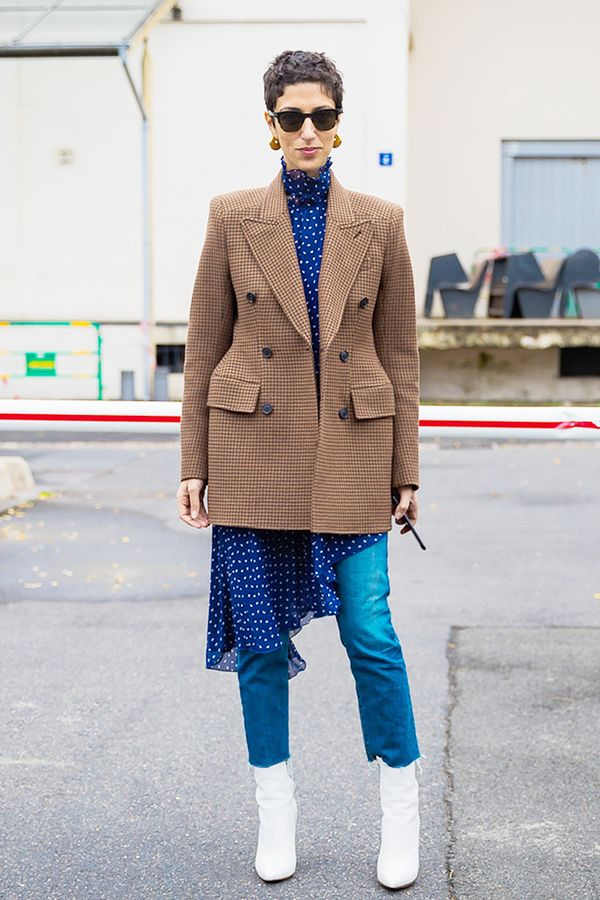 Take note! This is how a dress over jeans is done.